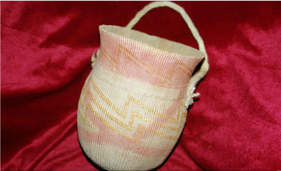 A basket made of straw found at the Kungang tomb. PROVIDED TO CHINA DAILY